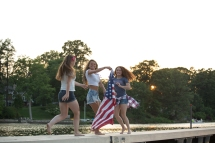 Teen girls spinning with US flag