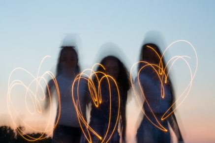 Teen girls playing with sparklers