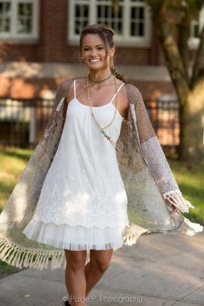 High School girl spinning in pretty dress