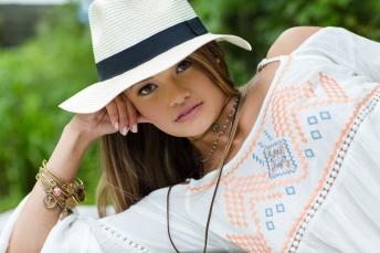 Senior portrait of teen girl in hat