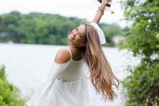 Long-haired girl spinning in sun