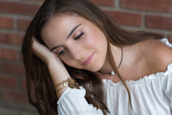 Senior portrait of high school girl looking down