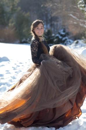 girl-spinning-tulle-skirt-winter-snow-scene