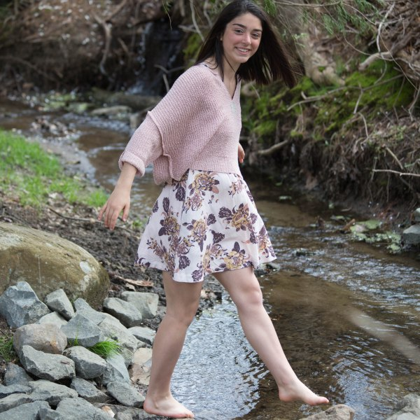 Teen photoshoot with girl in creek.