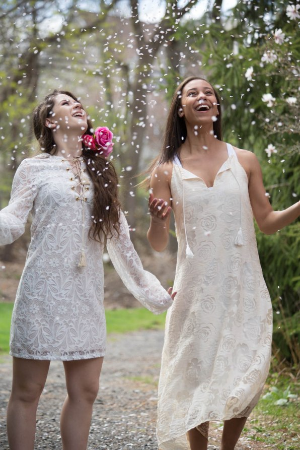 Teen photos of girls being rained on by flower petals