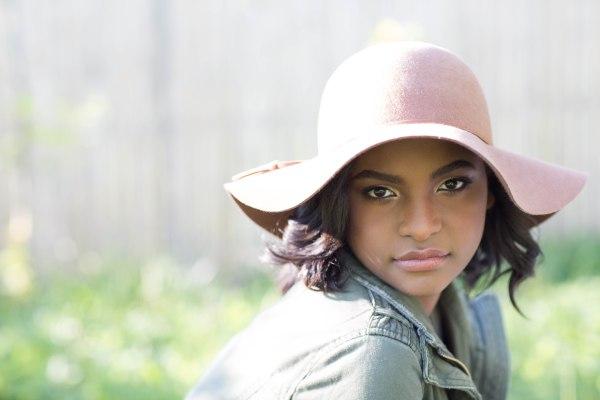 girl wearing a boho hat sunlit