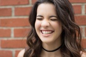 Senior portrait of girl laughing