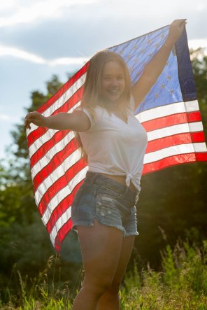 High School Senior portrait of sun-kissed girl with American flag