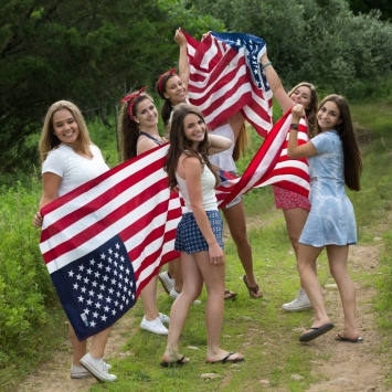 High School senior girls with flags celebrating