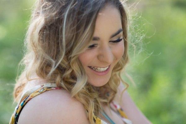 Teen girl laughing for senior portrait
