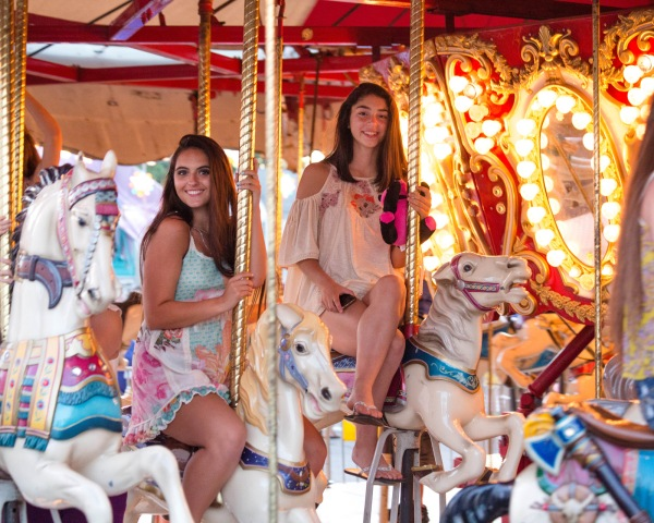 Senior photos on the merry go round at carnival