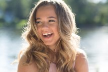 Senior pictures of sunlit girl laughing