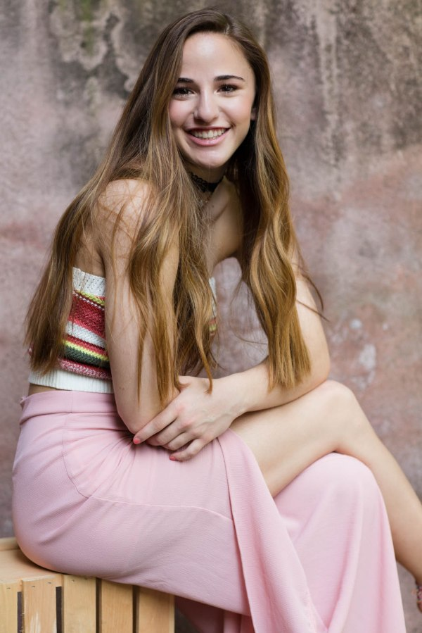 Girl pretty in pink senior picture